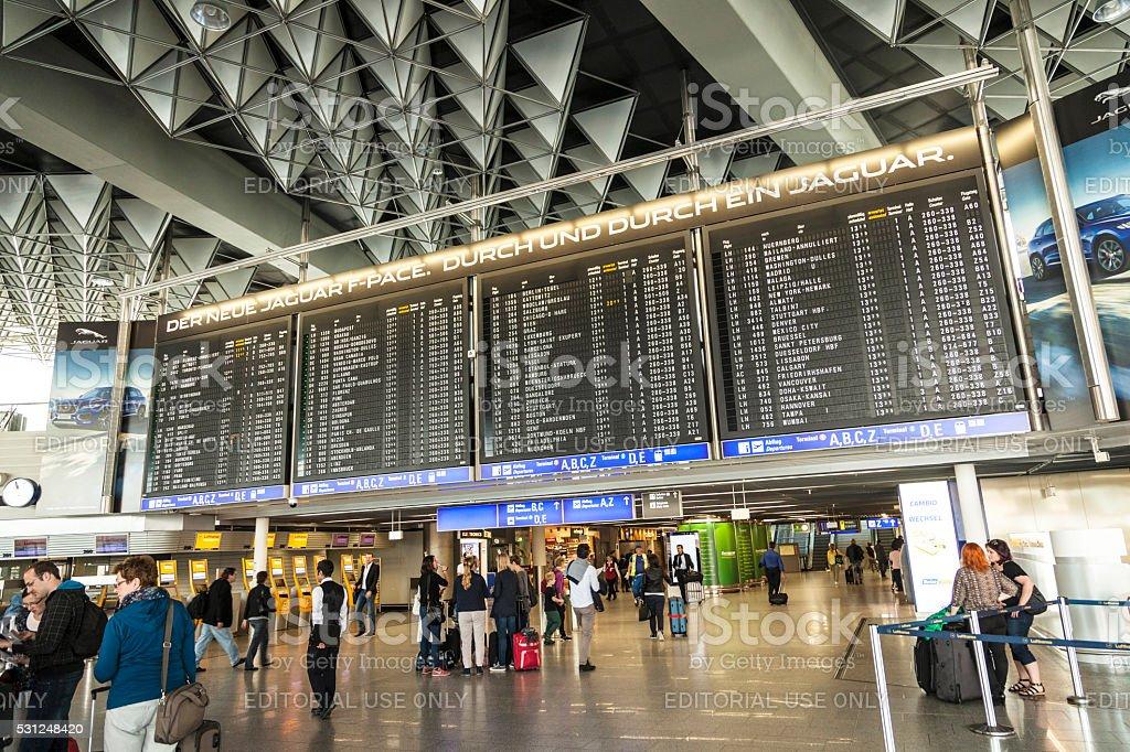 Travelers at public area at international Frankfurt Airport stock photo