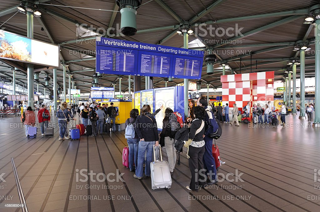 Travelers at Schiphol railway station in the Netherlands stock photo