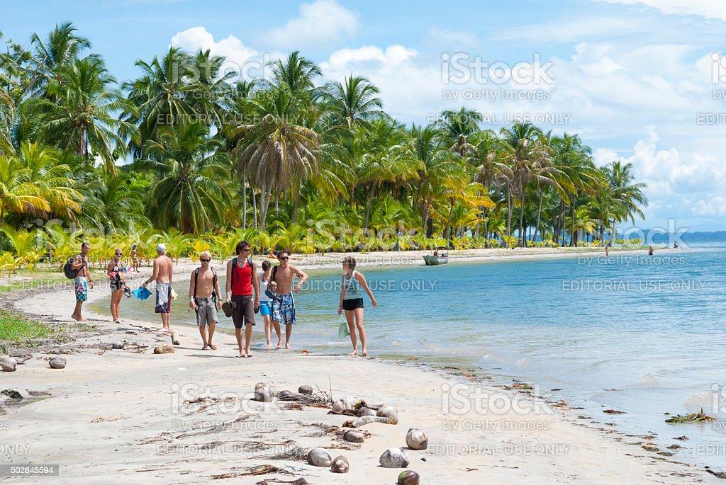 Travelers at the beach - Bocas del Toro, Panama stock photo