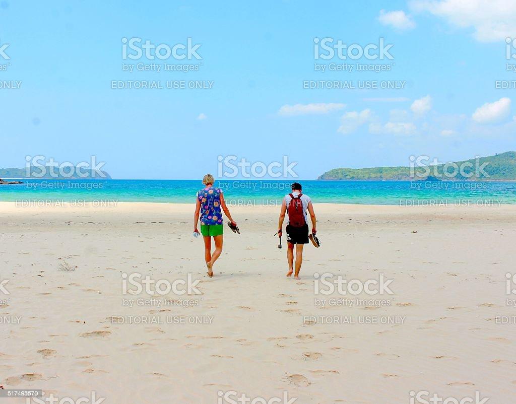 Travelers at the Beach stock photo