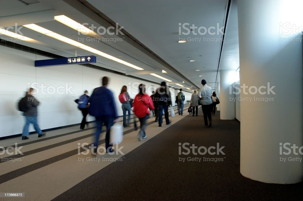 Travelers heading towards customs royalty-free stock photo
