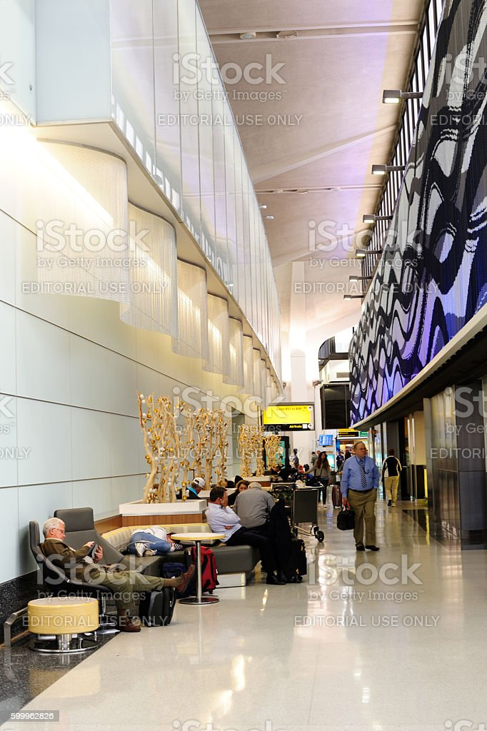 Travelers in Hallway at Newark Airport Terminal stock photo