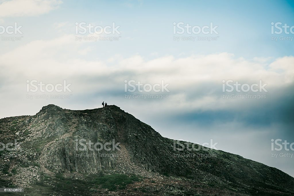 Travelers on the top of the mountain stock photo