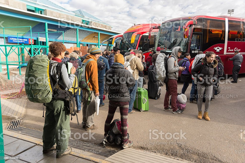 Travelers waiting for boarding autobus in Puno, Peru stock photo