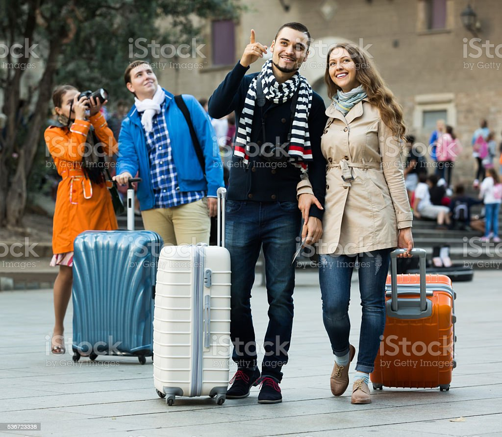 travelers with baggage sightseeing and smiling in autumn stock photo