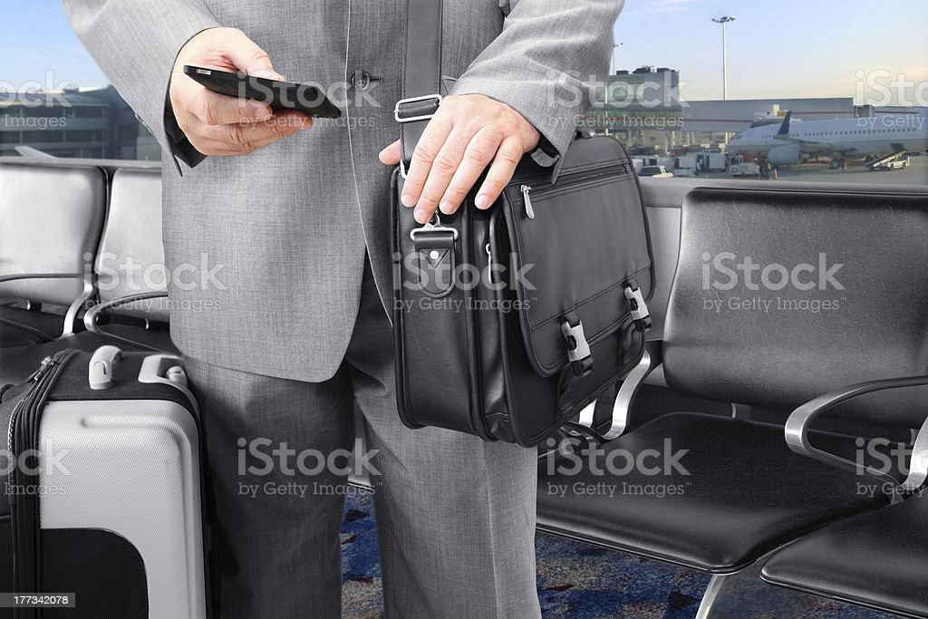 Traveling Businessman Calling by Phone at the Airport royalty-free stock photo