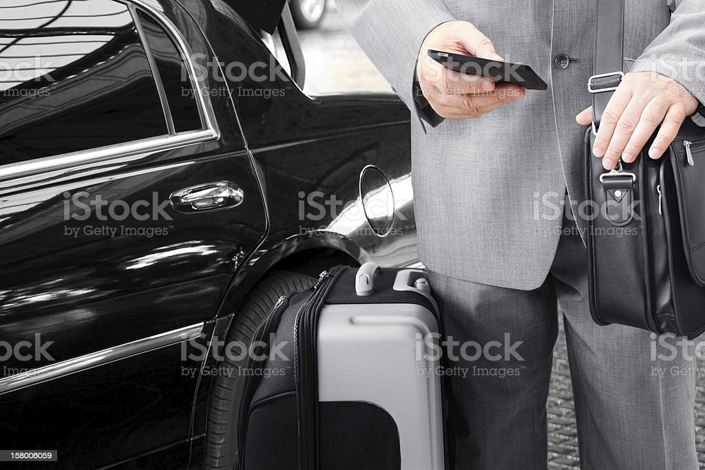 Traveling Businessman Calling by Phone royalty-free stock photo
