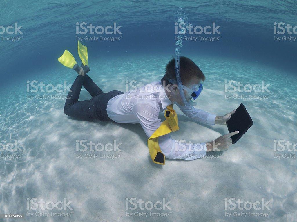 Traveling Businessman Relaxing Using Digital Tablet Underwater stock photo