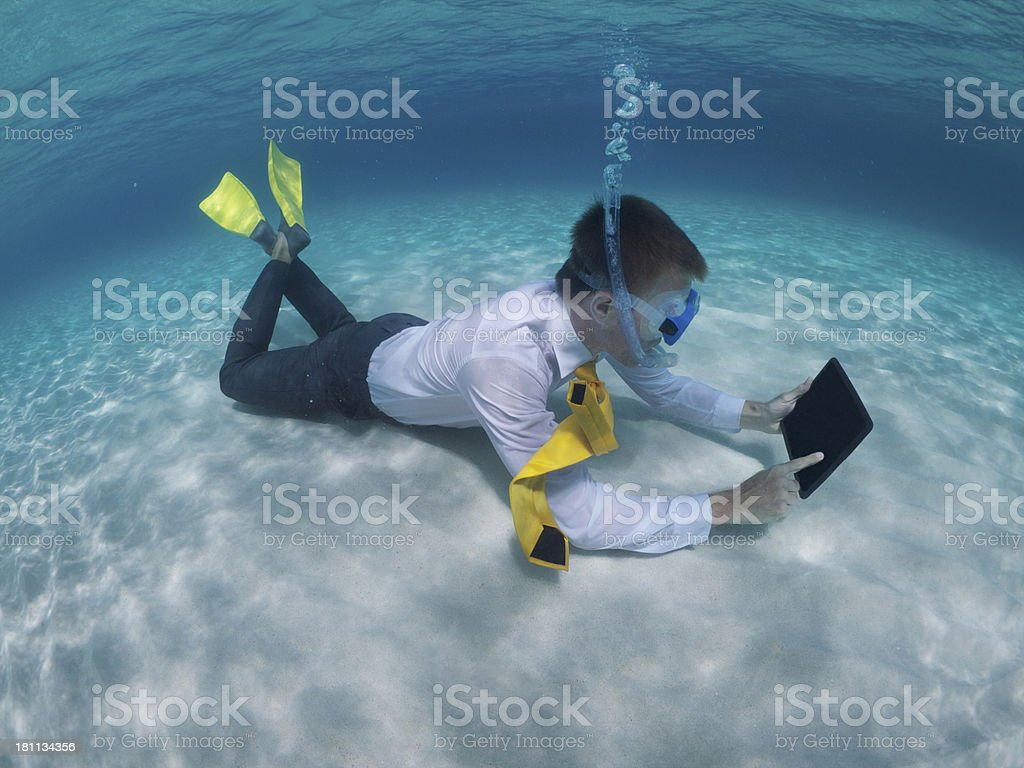 Traveling Businessman Relaxing Using Digital Tablet Underwater stock photo