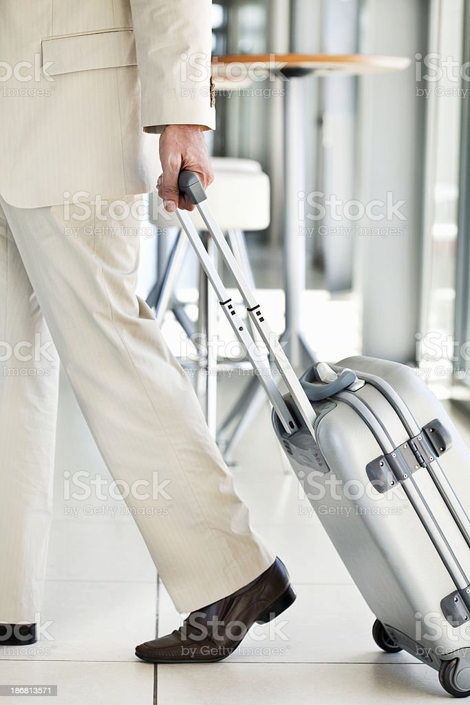 Traveling Businessman Rolling Luggage royalty-free stock photo