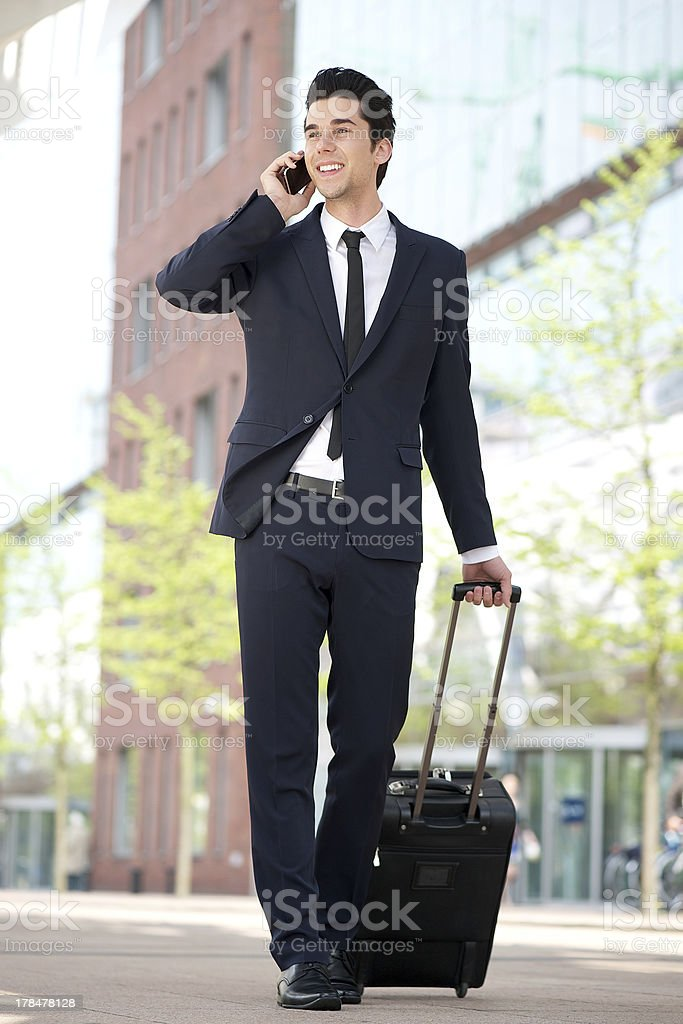 Traveling businessman talking on mobile phone royalty-free stock photo