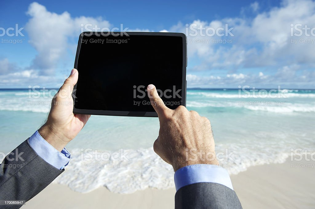 Traveling Businessman Using Touchscreen Digital Tablet Computer Tropical Beach royalty-free stock photo