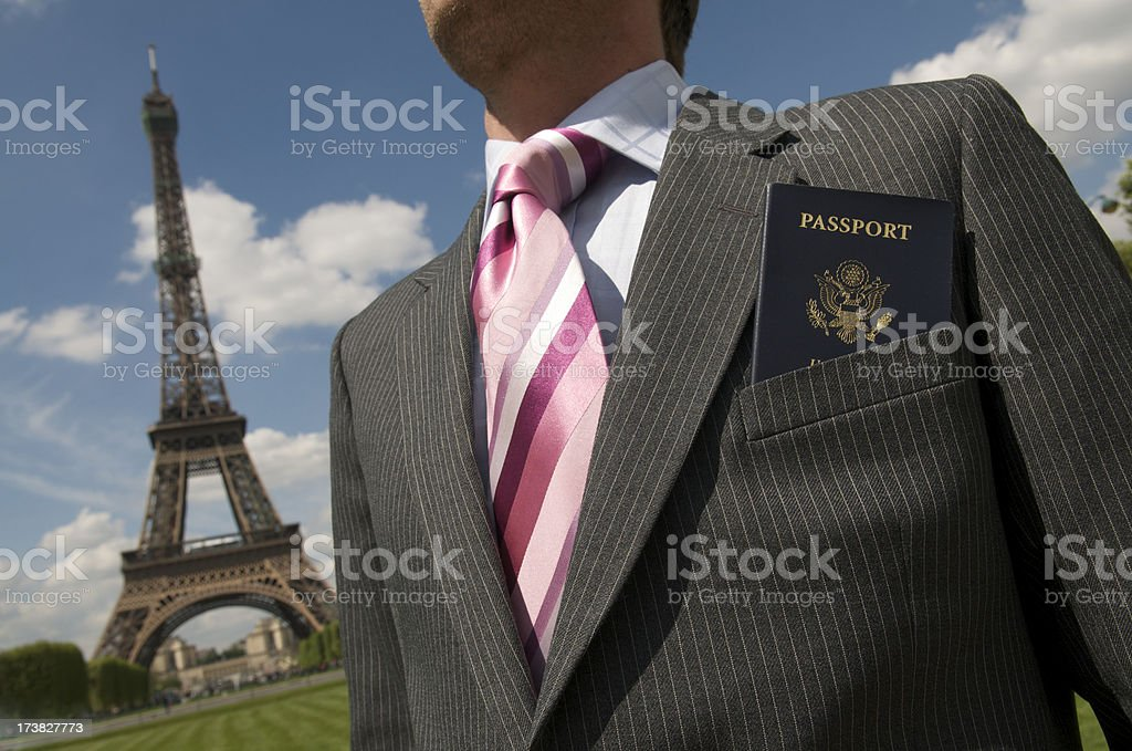 Traveling Businessman with Passport in front of Eiffel Tower royalty-free stock photo