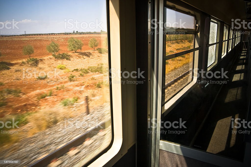 Traveling By Train in Motion Corridor Looking out of Window royalty-free stock photo