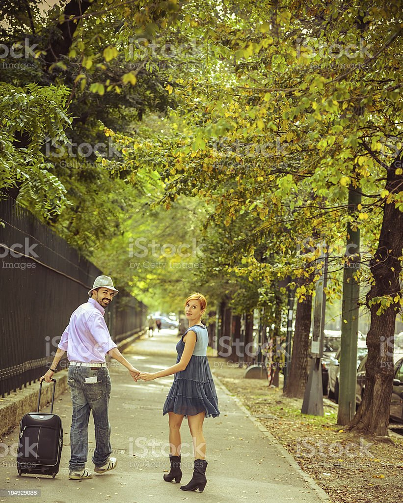 Traveling Couple walking with suitcase stock photo