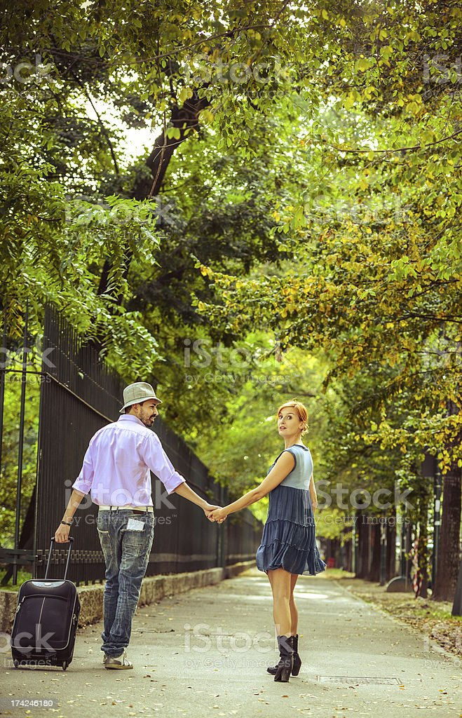 Traveling Couple walking with suitcase royalty-free stock photo