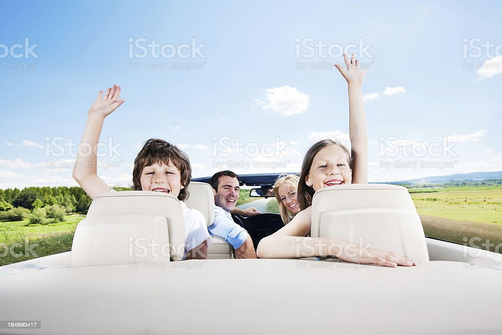 Traveling family driving in the Convertible car. royalty-free stock photo
