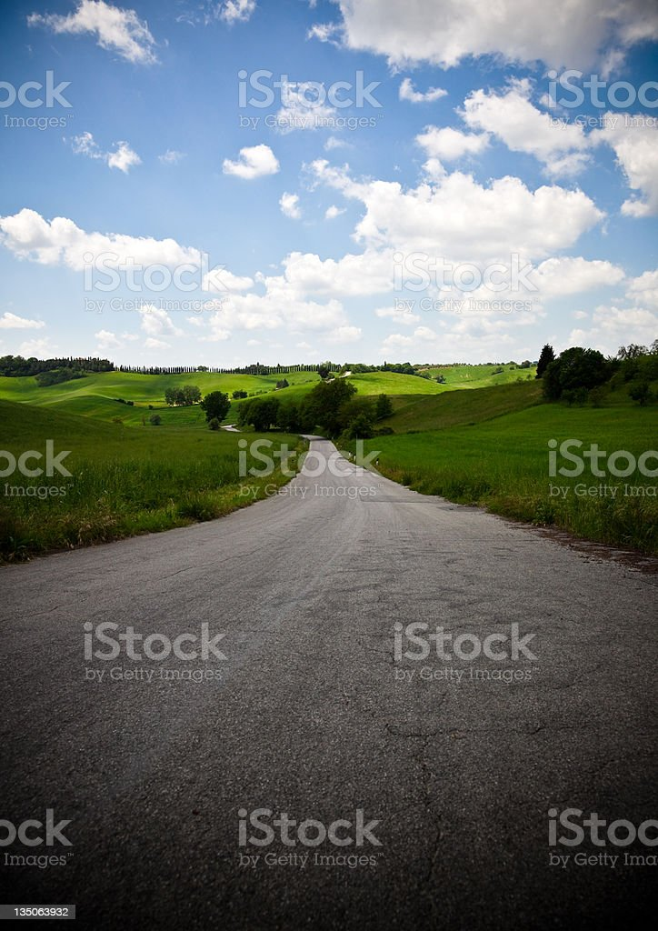 Traveling in Tuscany on a Rural Roadway stock photo