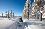 Traveling Lapland with snowmobile