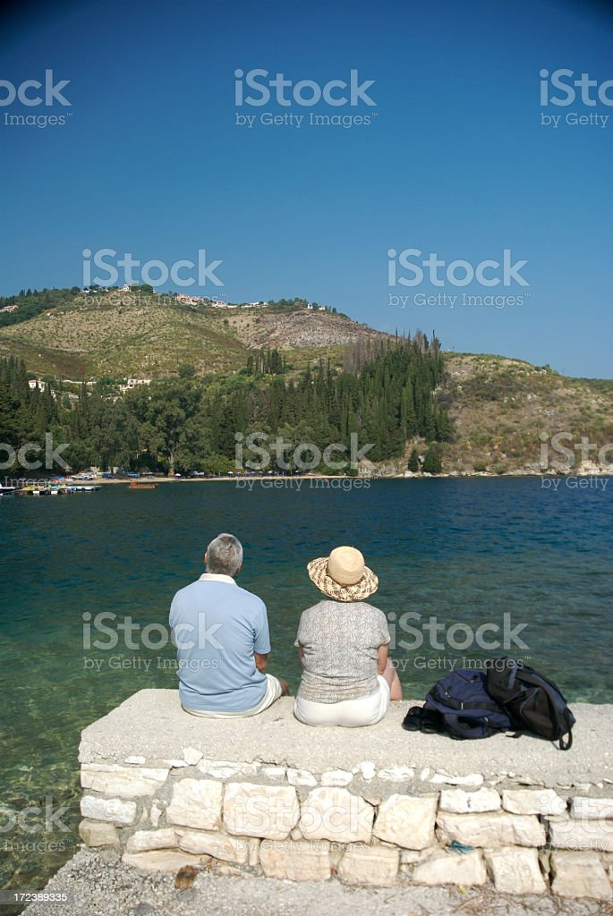 Traveling Senior Citizen Couple Enjoys Mediterranean Scene stock photo