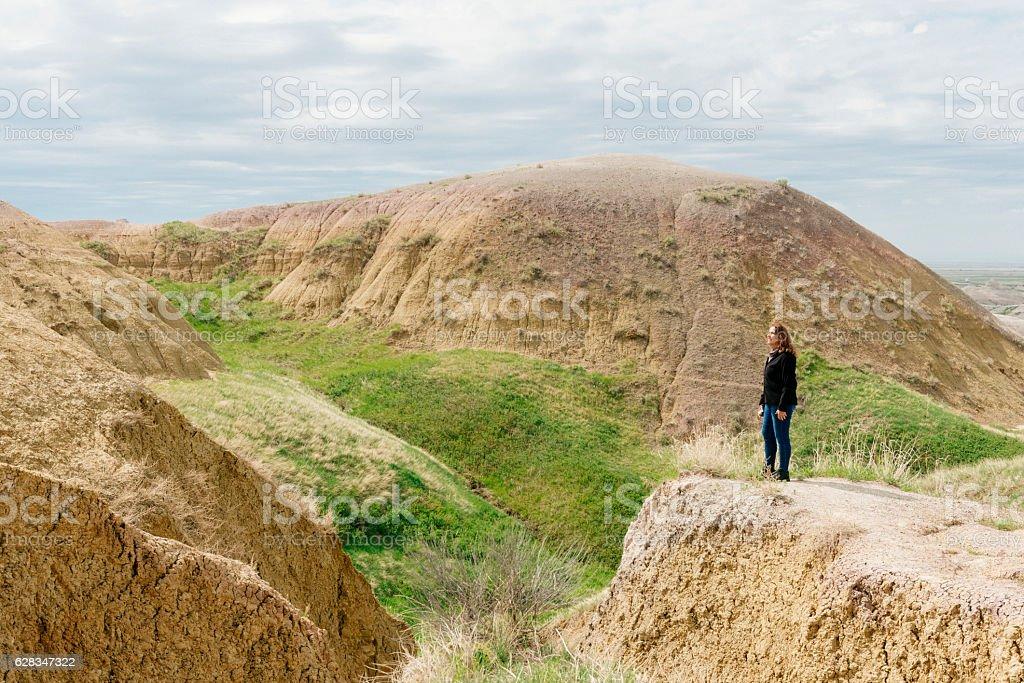 Traveling Senior Woman Enjoys View Badlands National Park South Dakota stock photo
