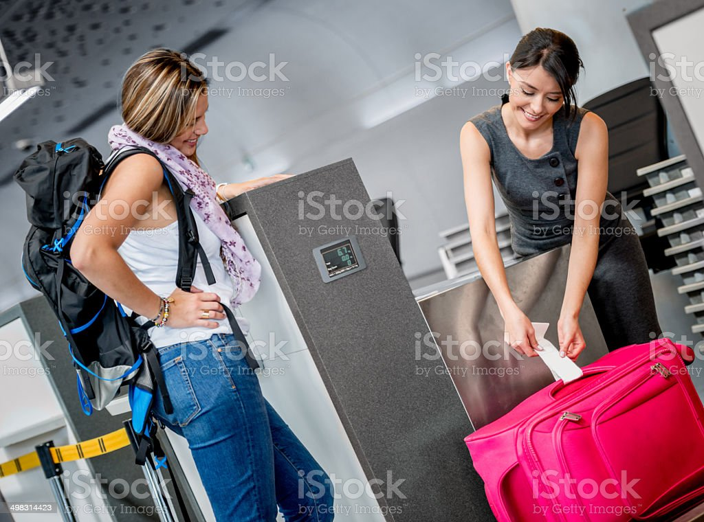 Traveling woman doing check-in stock photo