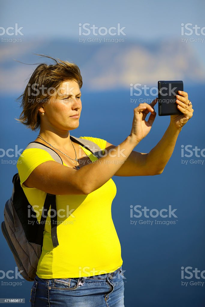 traveling young woman with tablet computer royalty-free stock photo