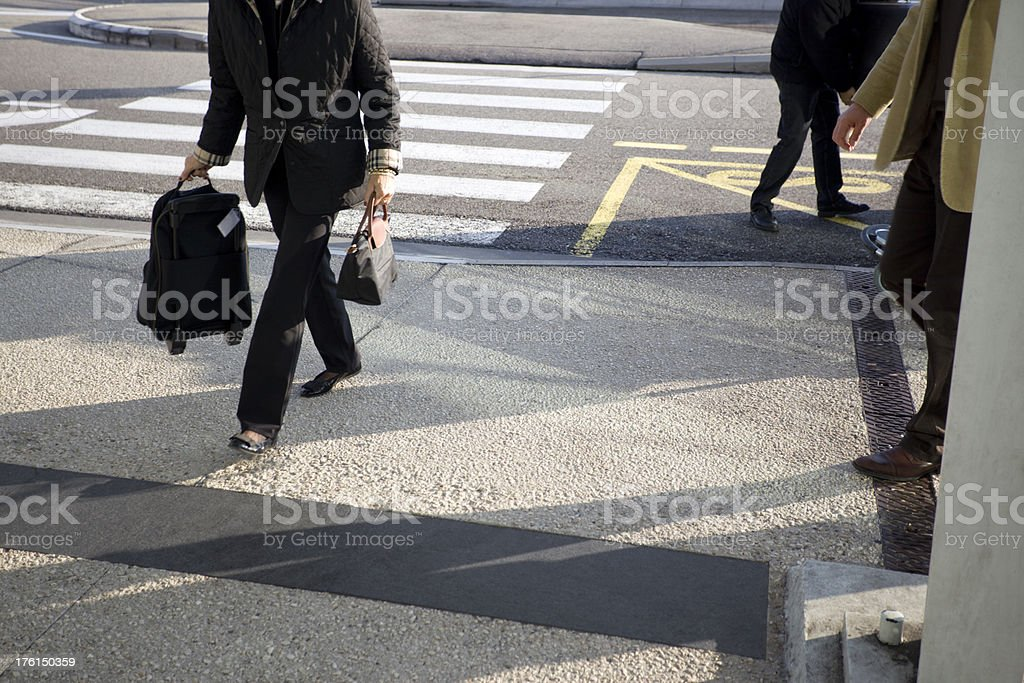 Traveller Carrying Luggage to Check-in at the Airport Curb stock photo
