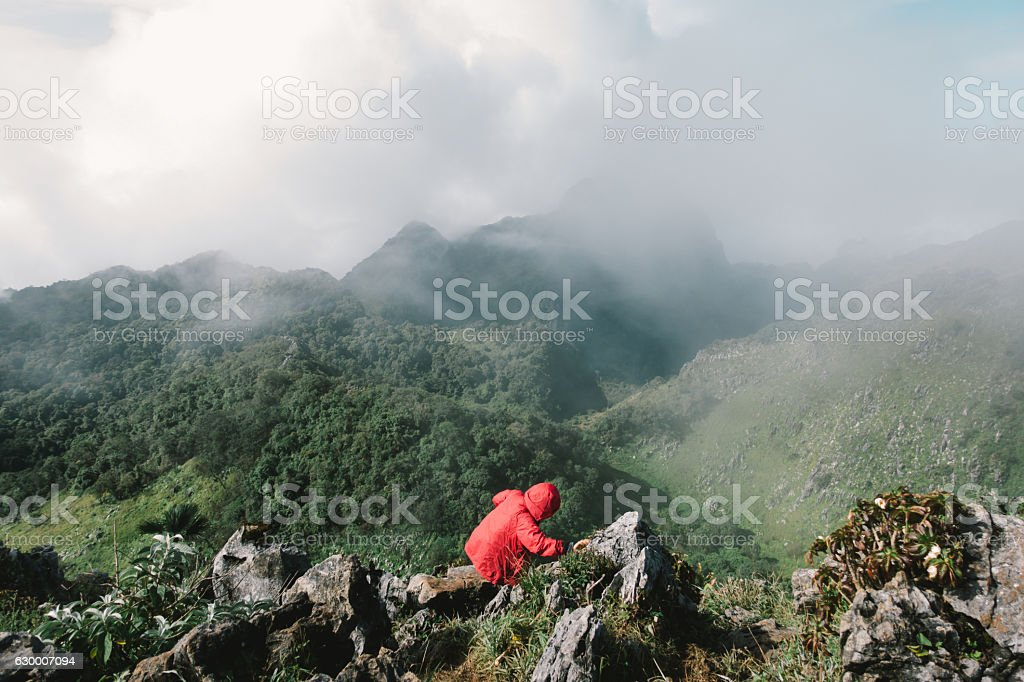traveller is walking down of a hill stock photo