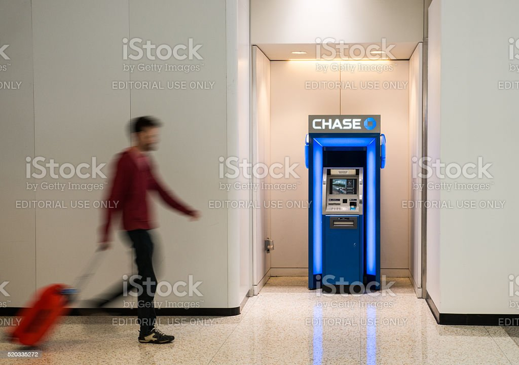 Traveller walking towards a Chase Bank ATM stock photo