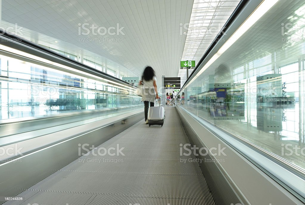 Traveller with bag at airport royalty-free stock photo