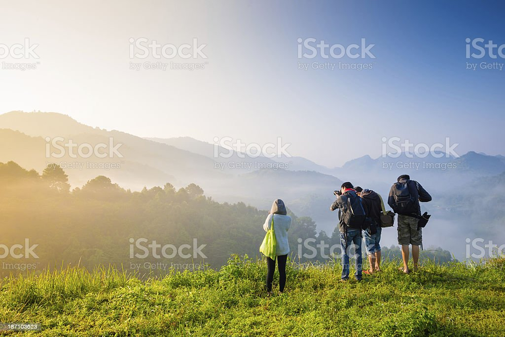 Traveller with camera at mountains . stock photo