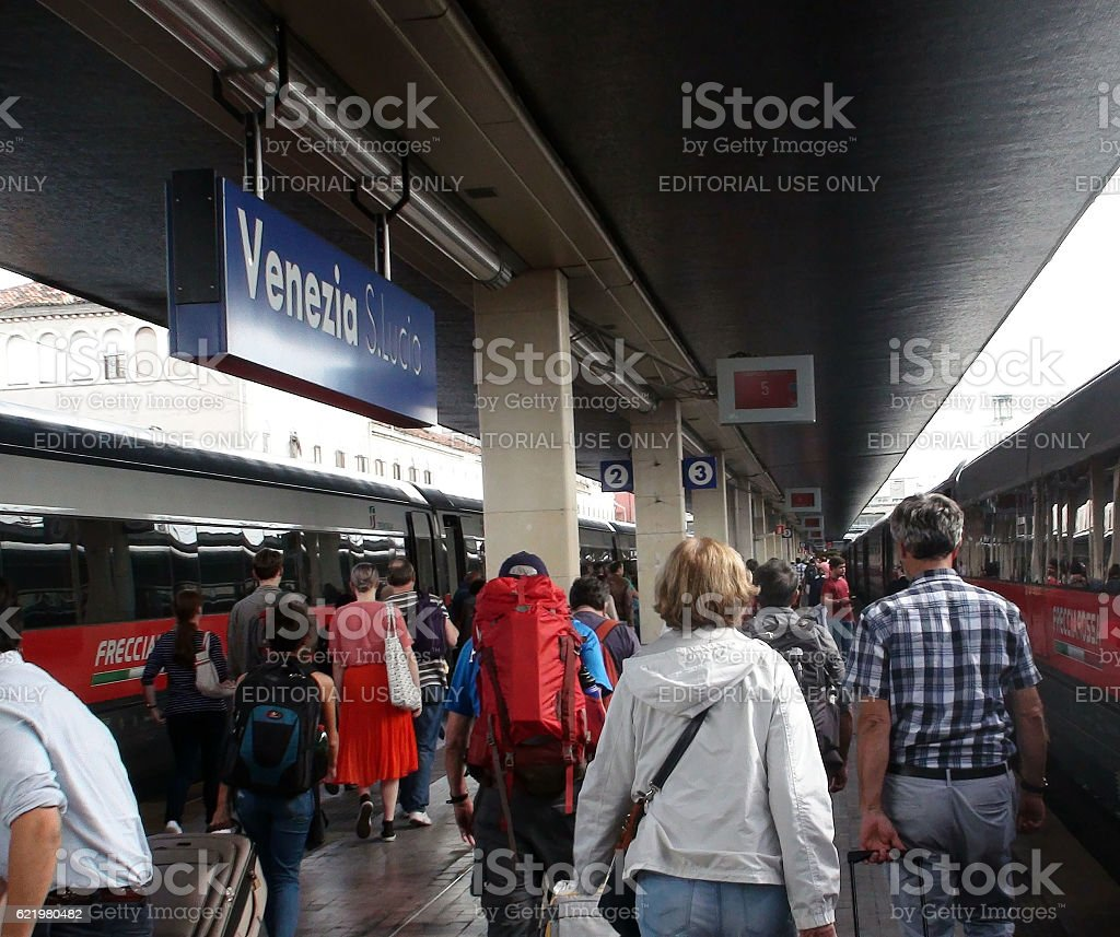 Travellers Arriving At Venezia Santa Lucia Railway Station In Italy stock photo