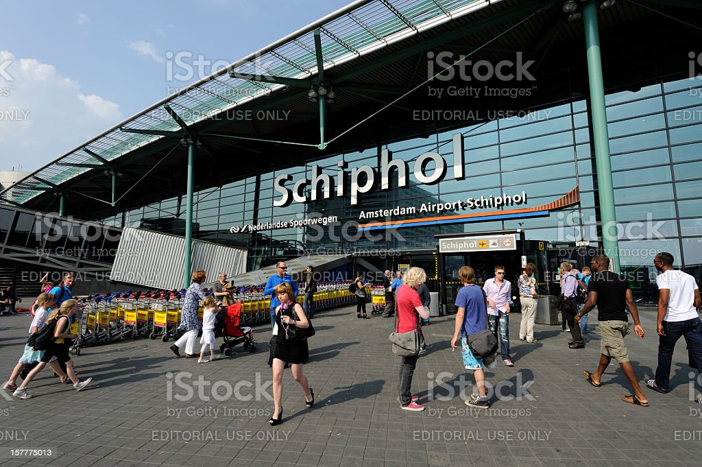 Travellers at the entrance of Amsterdam Airport Schiphol stock photo