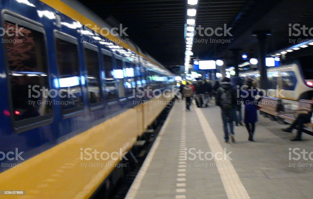 Travellers Departing From Station Platform After Stepping Out From Train stock photo