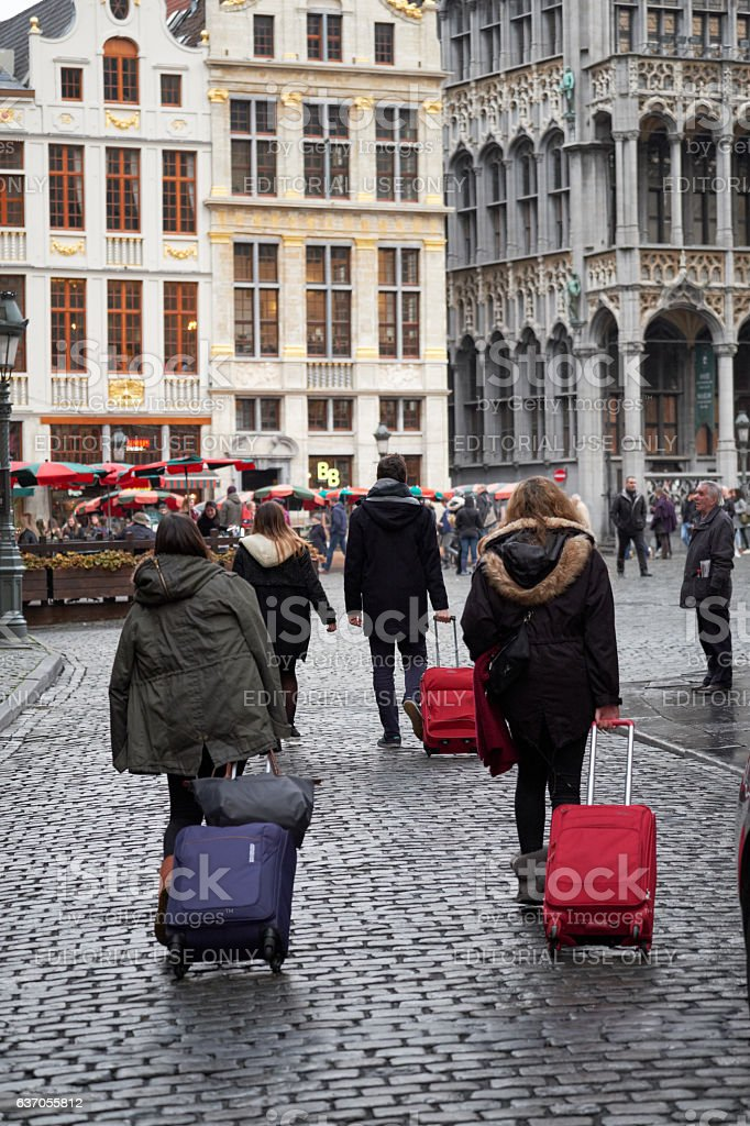 Travellers drag their bags stock photo