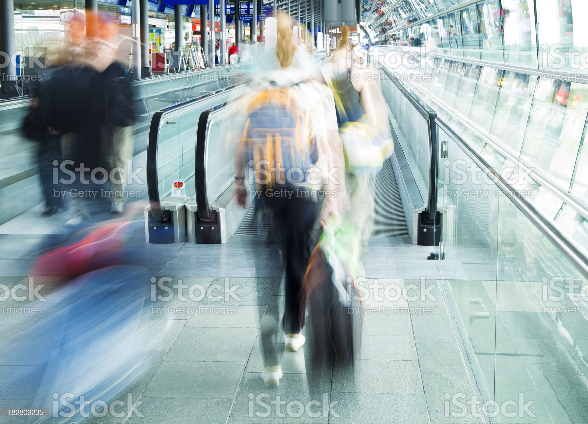 Travellers Entering Moving Walkway at Airport, Blurred Motion royalty-free stock photo
