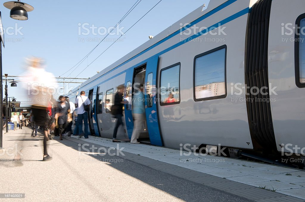 Travellers entering train royalty-free stock photo