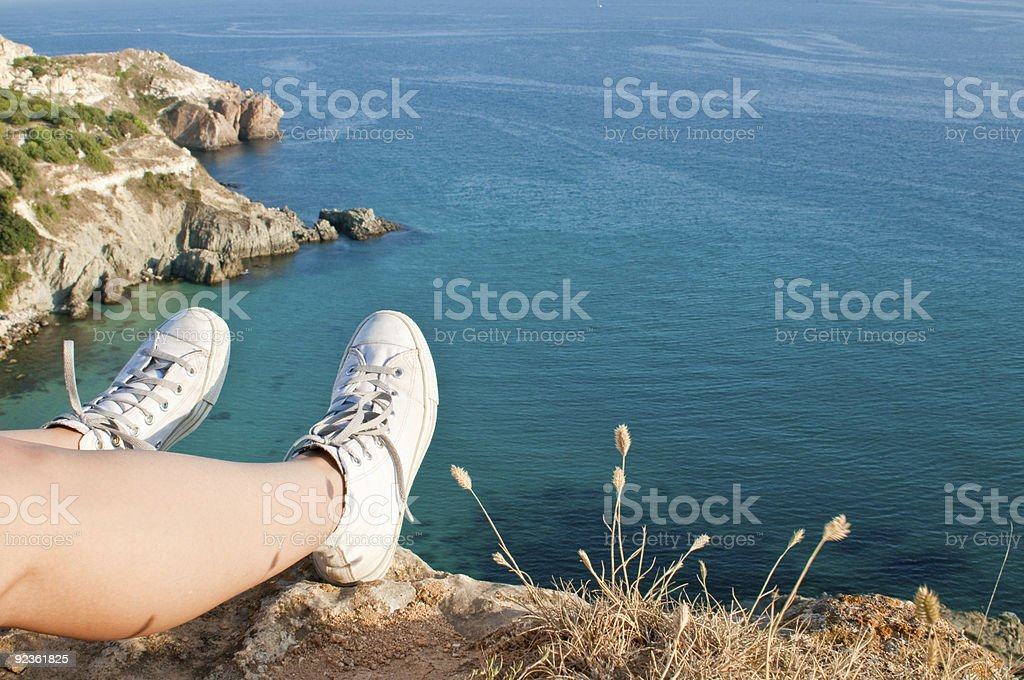 traveller's feet in sneakers royalty-free stock photo