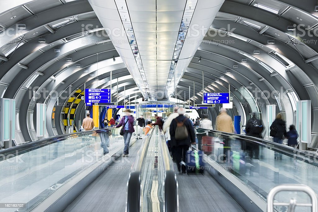 Travellers on Moving Walkway at Airport royalty-free stock photo