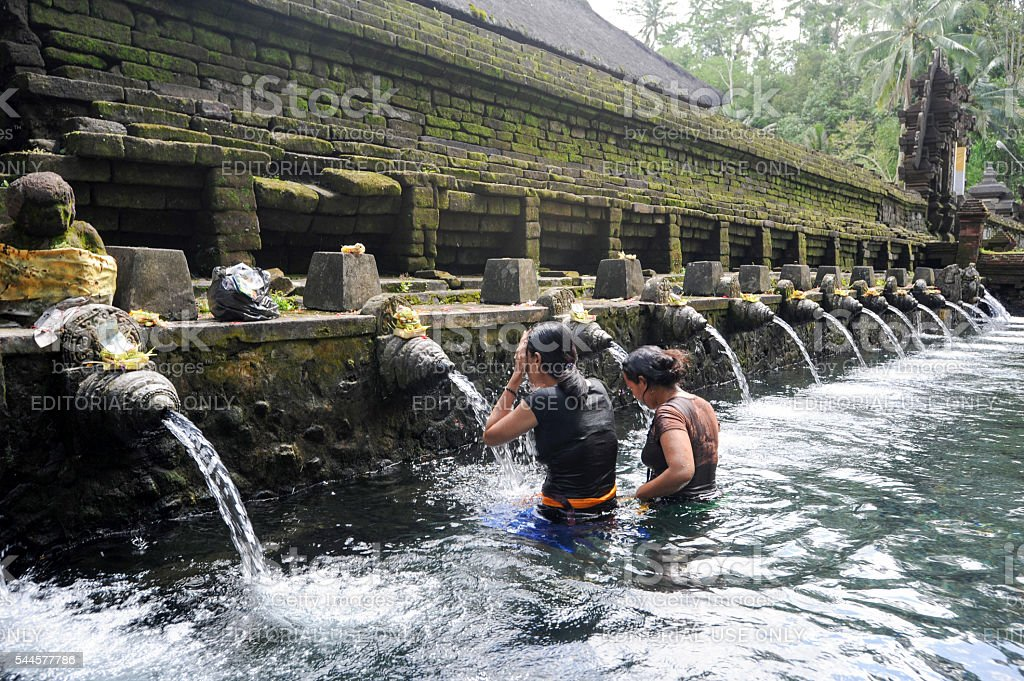 Travellers praying and take a bath at holy spring water stock photo
