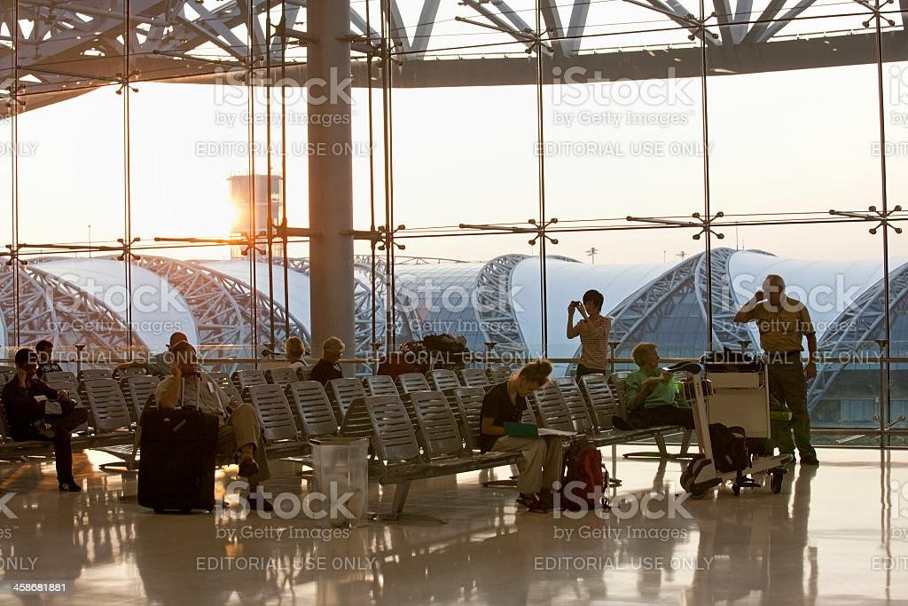 Travellers waiting at an international airport. royalty-free stock photo
