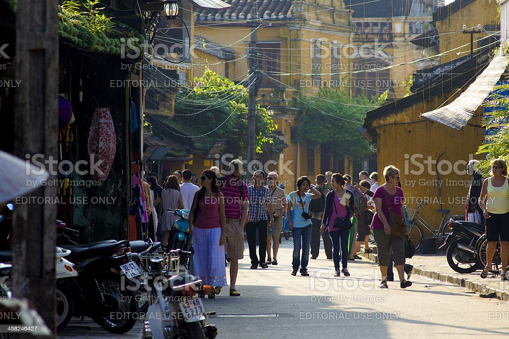 Travellers walk on the street of Hoi An royalty-free stock photo