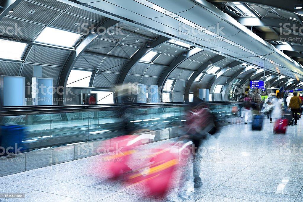 Travellers Walking Down Corridor royalty-free stock photo