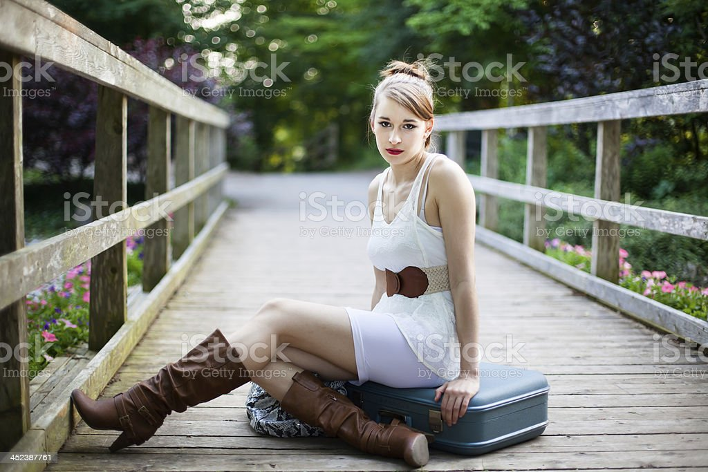 Travelling Girl on Wooden Bridge in a White Dress stock photo