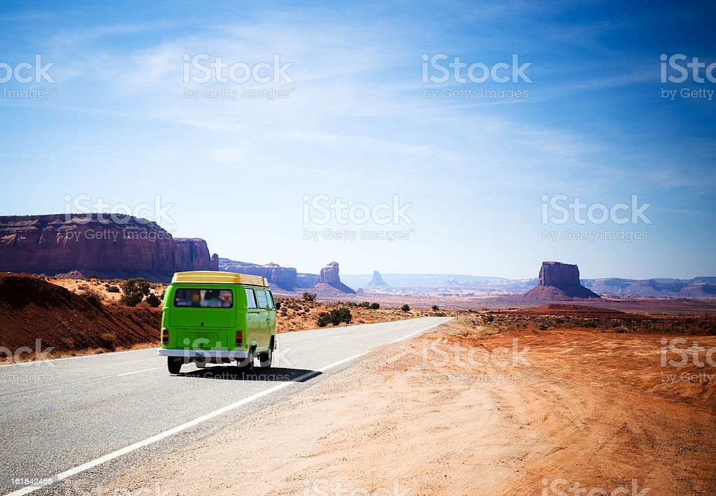 Travelling in the Monument Valley With a Green Old Van stock photo