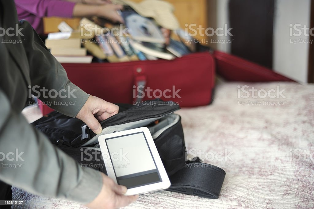 Travelling light with e-reader royalty-free stock photo
