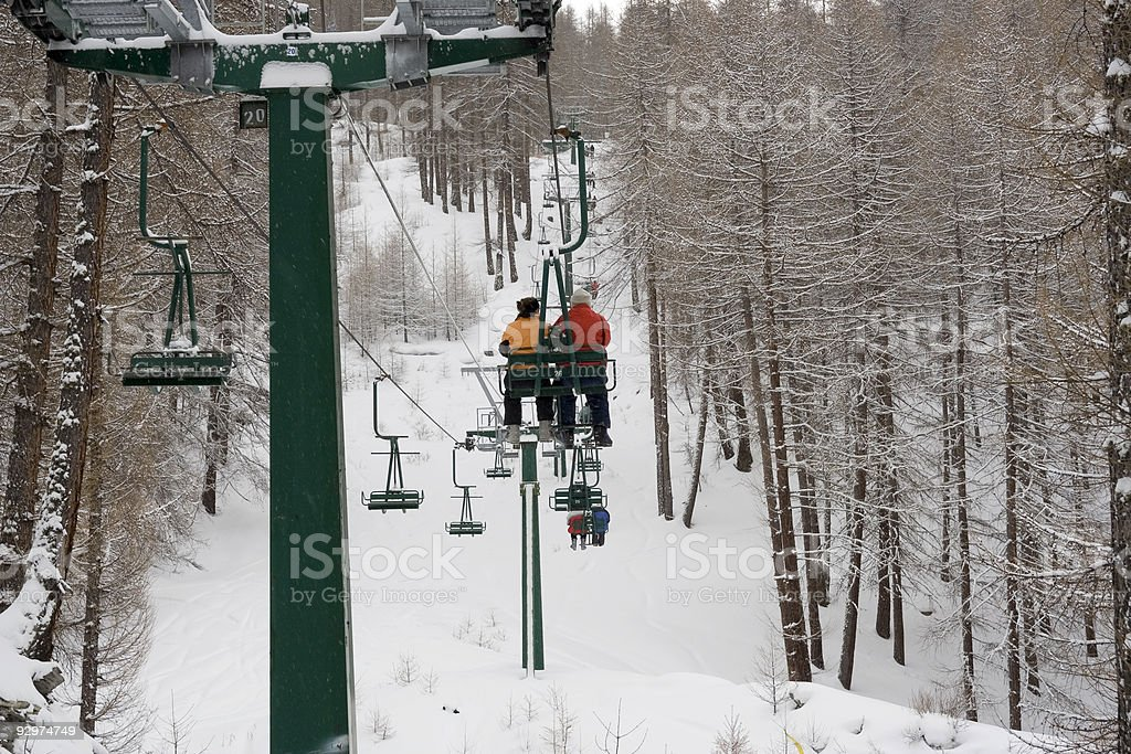 Travelling up the chair lift stock photo