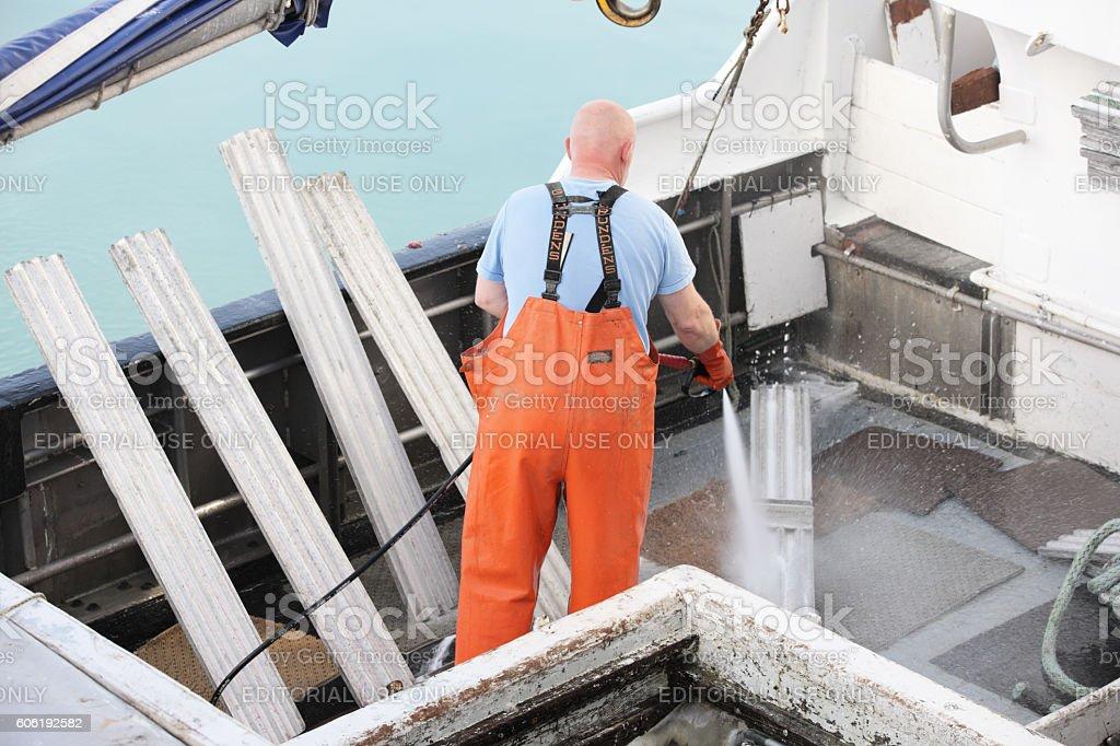 Trawler Fisherman Cleaning Nautical Equipment stock photo