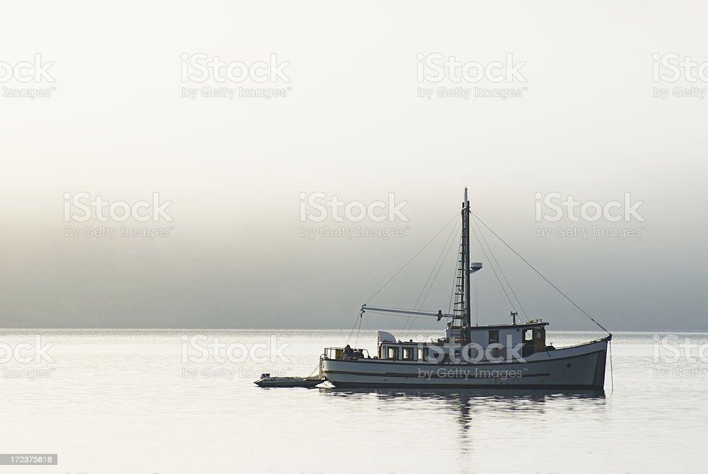 Trawler In Early Morning Fog royalty-free stock photo